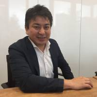 Munekatsu Ota, CEO of Rakuten Lifull Stay Inc., speaks at the company's office in Tokyo earlier this month. | ALEX MARTIN