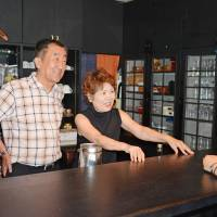 Yukio Shintani and his wife, Tamiko, talk about their experience participating in a minpaku event, in which homeowners take payment from travelers for hosting them in their homes, in Tokushima on Aug. 14. | KYODO
