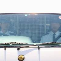A van carrying Vayron Jonathan Nakada Ludena arrives at a police station in Kumagaya, Saitama, in May 2016. KYODO