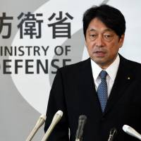 Defense Minister Itsunori Onodera speaks at a news conference at the ministry's headquarters in Tokyo on Friday. | AFP-JIJI