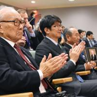 Tomihisa Taue (center), mayor of the atomic-bombed city of Nagasaki, attends the signing ceremony of the world's first comprehensive treaty to prohibit nuclear weapons, with atomic bombing survivors at the U.N. headquarters in New York on Wednesday.   KYODO