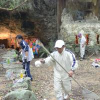 Four teens arrested over vandalism at site of Okinawa wartime mass suicide