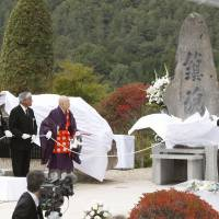 A monument is unveiled Wednesday in the Nagano Prefecture village of Otaki at the foot of Mount Ontake to mark the third anniversary of the volcano's eruption. | KYODO
