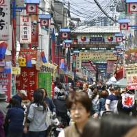 People walk through Korea Town in Ikuno Ward, Osaka. Ethnic Koreans living in Japan are nervously watching growing tensions due to North Korea's nuclear and missile program and are worried about a possible backlash against their community. | KYODO