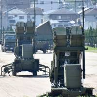 Patriot Advanced Capability-3 surface-to-air interceptors are seen at the Ground Self-Defense Force base in Kaita, Hiroshima Prefecture, in August. | KYODO