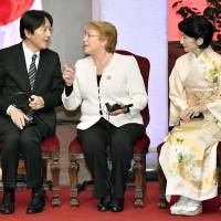 Prince Akishino speaks with Chilean President Michelle Bachelet as Princess Kiko looks on, at a ceremony commemorating the 120th anniversary of diplomatic ties between the two countries in Santiago on Wednesday. | KYODO