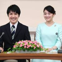 Princess Mako and Kei Komuro, her fiance, discuss their engagement at a news conference in Tokyo's Akasaka district on Sunday. | KYODO