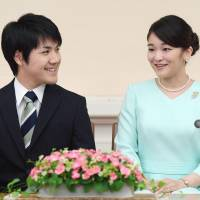 Princess Mako and her fiance Kei Komuro face reporters at a much-anticipated news conference in Tokyo's Akasaka district on Sunday. | KYODO