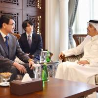 Foreign Minister Taro Kono holds talks with his Qatari counterpart, Sheikh Mohammed bin Abdulrahman Al Thani, in Doha on Saturday. | KYODO