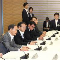 Cabinet ministers attend a meeting at the Prime Minister's Office on Tuesday to discuss a delay in the road map for decommissioning the Fukushima No. 1 nuclear power plant. | KYODO