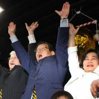 Incumbent Sakai Mayor Osami Takeyama (center) celebrates his victory in Sunday's mayoral poll at his campaigning office in the Osaka Prefecture city. | KYODO