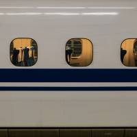 A shinkansen is seen in this undated image. On Sunday, a shinkansen passenger's tablet computer apparently caught fire, forcing an emergency halt to the train. | ISTOCK