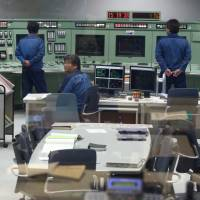 Tokyo Electric Power Company Holdings Inc. employees take part in a drill in the simulator of the central control room for a reactor inside the seismic isolation building at the company's Kashiwazaki-Kariwa nuclear power station in Kashiwazaki, Niigata Prefecture, in  February 2015. | BLOOMBERG