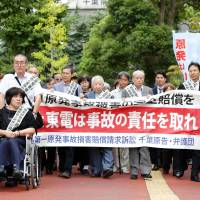 Tepco again ordered to pay damages over nuclear disaster but claims against state dismissed