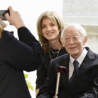 Hideo Tsuchiyama, who was exposed to radiation when he entered Nagasaki on Aug. 10, 1945, the day after the U.S. atomic bombing, is seen with former U.S. Ambassador to Japan Caroline Kennedy in the city in December 2013. Tsuchiyama died Saturday at the age of 92. | KYODO
