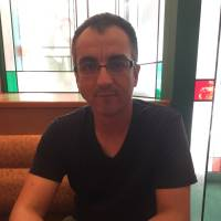 Ibrahim Yener, a Turkish resident of Osaka who won a lawsuit against a second-hand car dealer for discriminating against him because he was not Japanese, is interviewed in Osaka earlier this month. | ERIC JOHNSTON