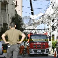 Collapsed scaffolding is seen Sunday in Shinagawa Ward, Tokyo, after buffeted by strong winds brought by Typhoon Talim. | KYODO