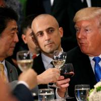 U.S. President Donald Trump and Prime Minister Shinzo Abe toast during a luncheon hosted by the United Nations secretary-general in New York on Tuesday. | REUTERS