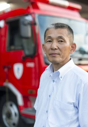 Yukio Takayama, former deputy superintendent and chief of the 8th district Hyper Rescue battalion, revisits his former workplace in Tachikawa on July 13.