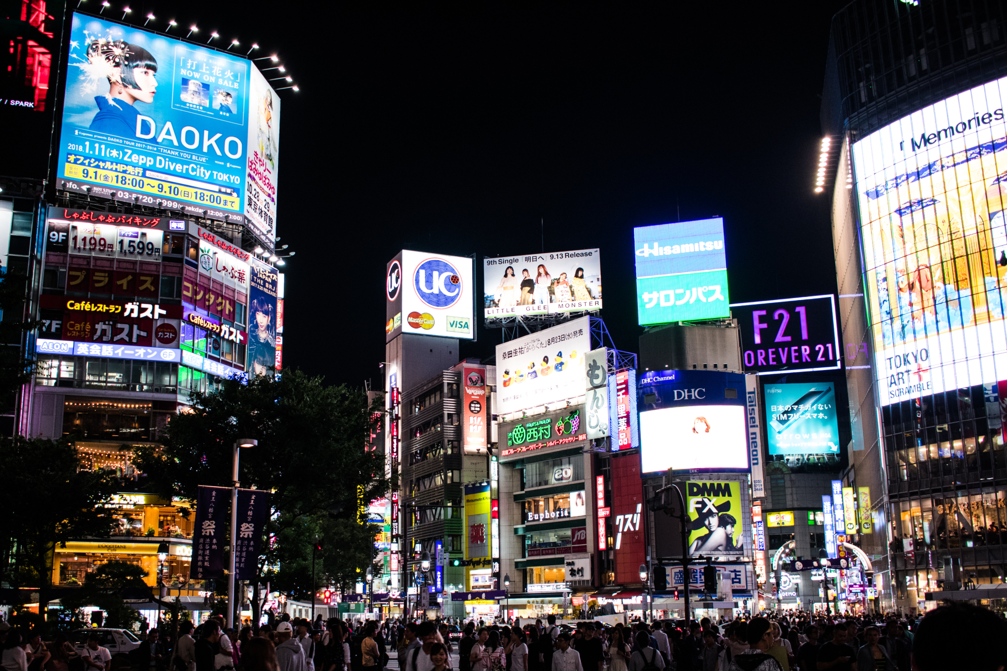 Prominent placement: A billboard promoting emerging artist Daoko (top left) overlooks a busy Shibuya Crossing in early September. | NICHOLAS SEAGREAVES