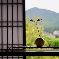 Outside in: A decoration sits atop a table in the restored Hisano Samurai house in Akizuki, with Mount Kosho in the background. | OSCAR BOYD