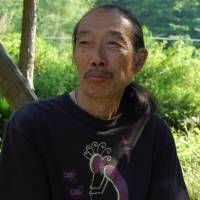 Citizen skepticism: The writer, philosopher and farmer Masanori Oe, profiled in Andy Couturier's 'The Abundance of Less,' lives off the land and keeps a flame from the atomic bombing of Hiroshima alive in a lantern in his house. | ANDY COUTURIER