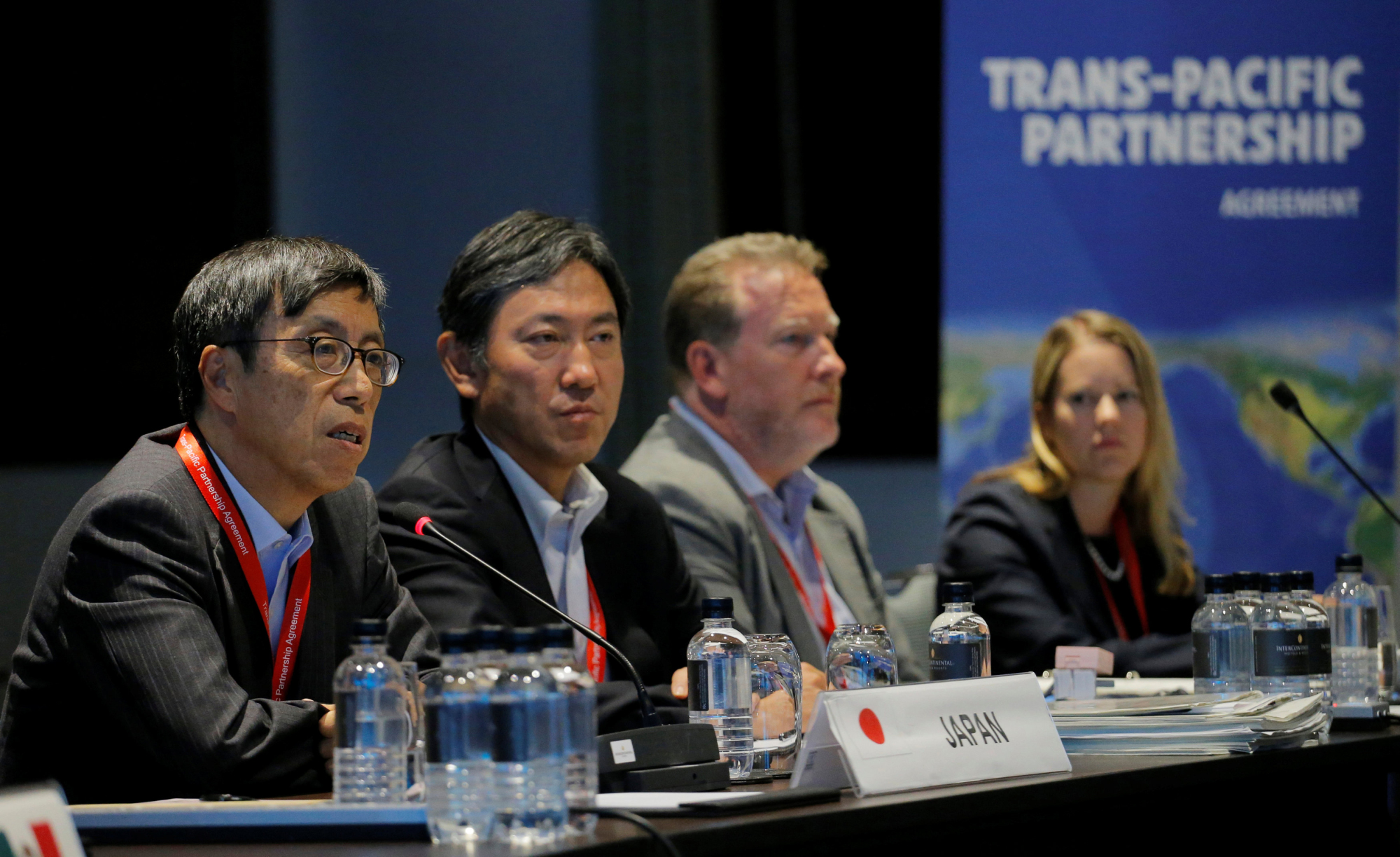 Japan's chief trade negotiator, Kazuyoshi Umemoto (left) speaks at the Trans-Pacific Partnership seniors leaders meeting in Sydney on Thursday. Had the United States stayed in the TPP, it would have been the first true 21st century trade agreement. | REUTERS