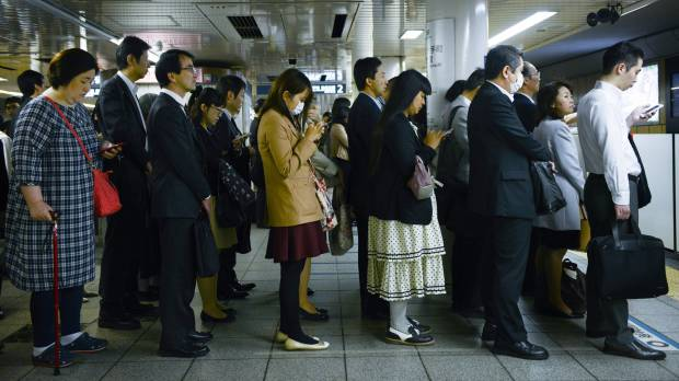 Could even a missile alert stop Japanese from going to the office?