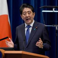 Prime Minister Shinzo Abe announces at his office in Tokyo on Monday that he will dissolve the Lower House and call a snap election. | AFP-JIJI
