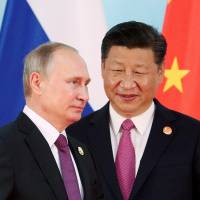 Rather than embracing political liberalization, both Russia and China have grown more authoritarian over the last couple of decades. | REUTERS
