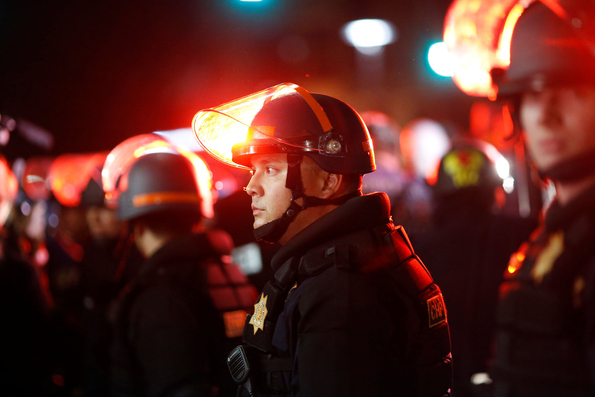 Police officers stand in a line as others render aid to an injured woman during a protest against a speech by conservative political commentator Ben Shapiro at UC Berkeley in Berkeley, California, on Sept. 14. Security for the event cost an estimated $600,000. | REUTERS