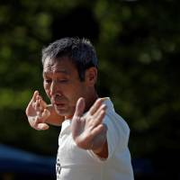 Masayoshi Koiso, a 69-year-old homeless man and a member of Newcomer 'H' Sokerissa!, performs at a park in Tokyo. | REUTERS