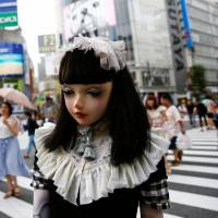 Go figure: Lulu Hashimoto takes a stroll in Tokyo. | REUTERS