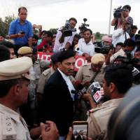 S. K. Garg Narwana, lawyer of Gurmeet Ram Rahim Singh, a 'godman,' speaks with the media on Aug. 28 after  his client was convicted of rape charges in Rohtak, Haryana state. | REUTERS