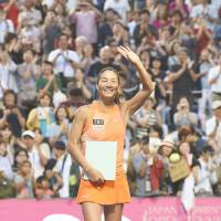 Kimiko Date waves to fans after the final match of her pro career on Tuesday in the Japan Women's Open at Ariake Tennis Forest Park. Date lost 6-0, 6-0 to Aleksandra Krunic. | AFP-JIJI
