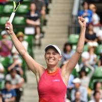 Denmark's Caroline Wozniacki celebrates after beating Russia's Anastasia Pavlyuchenkova 6-0, 7-5 in the final of the Toray Pan Pacific Open at Ariake Coliseum on Sunday. | AFP-JIJI
