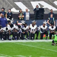 Thirteen Baltimore Ravens players kneel as the U.S. National Anthem is played before the game between the Jacksonville Jaguars and the Baltimore Ravens at Wembley Stadium in London Sunday. | STEVE FLYNN / VIA USA TODAY SPORTS
