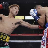WBO super flyweight champion Naoya Inoue lands a punch on challenger Antonio Nieves during their title fight in Carson, California, on Saturday. | AP