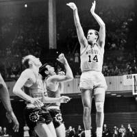 San Francisco Warriors star Tom Meschery, who lived in a Tokyo-area internment camp during World War II, takes a shot against the Philadelphia 76ers during the 1960s. | GOLDEN STATE WARRIORS