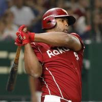 The Eagles' Carlos Peguero hits a two-run double in the third inning against the Fighters on Thursday night at Tokyo Dome. Tohoku Rakuten prevailed 6-4 over Hokkaido Nippon Ham. | KYODO