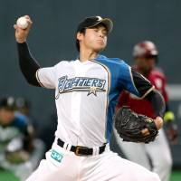 Fighters right-hander Shohei Otani unleashes a pitch against the Eagles on Tuesday night at Sapporo Dome. Otani earned the win in Hokkaido Nippon Ham's 7-0 rout of Tohoku Rakuten. | KYODO
