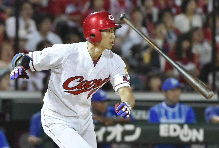 Carp rout BayStars to trim magic number to two