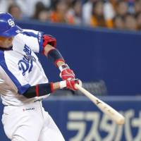 Yusuke Matsui bashes a two-run homer in the third inning on Tuesday against the Giants at Nagoya Dome. Chunichi defeated Yomiuri 10-2. | KYODO