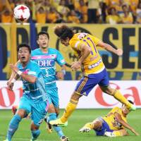 Vegalta Sendai's Naoki Ishihara (11) scores with a header in Sunday's 4-1 win over Sagan Tosu. | KYODO