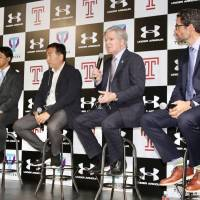 NCAA president Mark Emmert speaks during a panel discussion on Japan's planned college sports governing body with University of Tsukuba associate professor Tsuyoshi Matsumoto (far left), Dome Corporation CEO Shuichi Yasuda (second from the left) and Temple University professor Jeremy Jordan on Wednesday in Tokyo. | KAZ NAGATSUKA