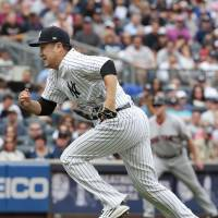 Tanaka has solid day as Yankees beat Red Sox