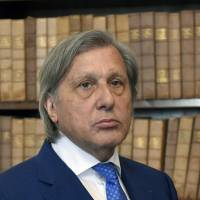 Former Romanian tennis player Ilie Nastase attends a news conference on Friday in Prague. | AP