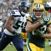 Packers rise to occasion in opening game