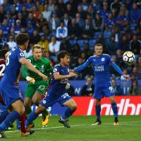 Leicester's Shinji Okazaki (second from right) chases the ball during the Foxes' match against Liverpool on Saturday in Leicester, England. Liverpool won 3-2. | AFP-JIJI