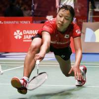 Nozomi Okuhara attempts to play a shot during her match at the Japan Open on Wednesday. | KYODO